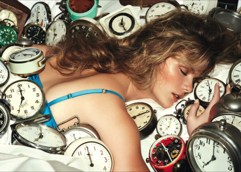 Image: Woman with clocks