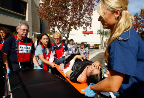 Image: Simulated earthquake victims arrive at an outdoor triage center during an earthquake drill at the University California San Diego Medial Center in San Diego