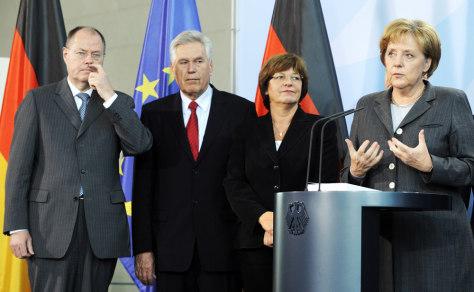 Image: Angela Merkel and economic panel