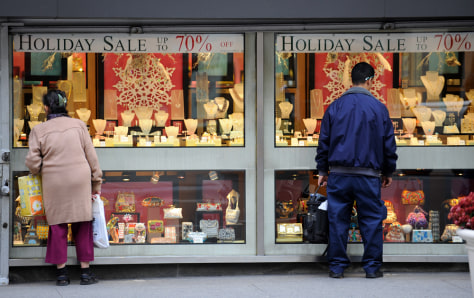 Image: Shoppers look at a jewelry shop