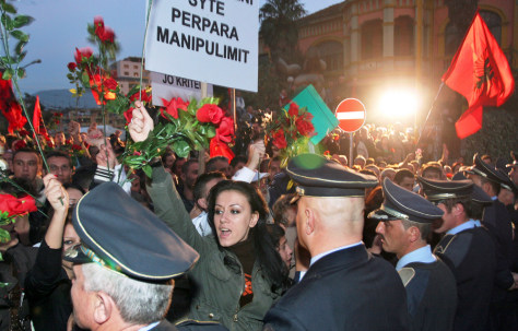 Image: Protesters shout slogans during a demonstration in Albania
