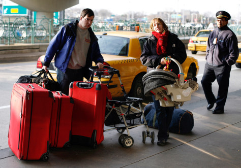 Image: Travelers get out of a cab at LaGuardia Airport