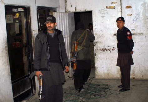 Image: Pakistani officers raid charity