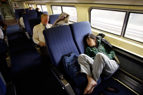 Image: Passengers relax while riding the train to Washington