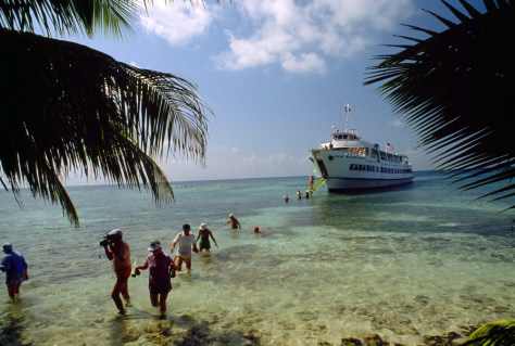 Image: Eco-tourists disembark from a cruise ship in Belize