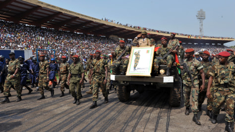 Image: Guinean soldiers escort the remains of late dictator Lansana Conte