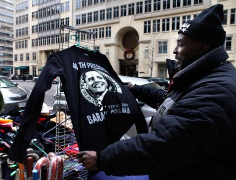 Image: Cornelius Williams, of Washington holds a T-shirt with the image of President-elect Barack Obama on it.
