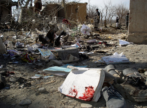 Image: School textbooks and shoes are seen on the ground after a suicide attack