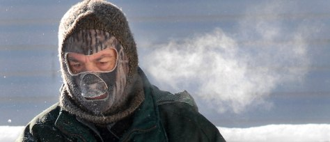 Image: Man bundled up in cold