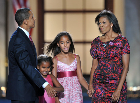 Image: Barack Obama, daughters Sasha (C-L) and Malia (C-R), and wife Michelle