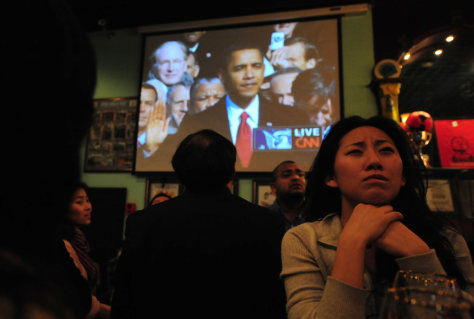 Image: A woman watches the inauguration of President Barack Obama