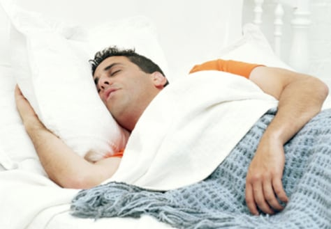 Image: Man sleeping in bed
