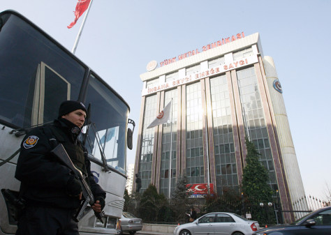 Image: A police officer stands outside the headquarters of Turkey's Metal Workers' Union