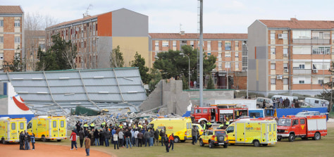 Image: Rescuers work in part of a sports center which collapsed in high winds killing four children and trapping and injuring others in Sant Boi Llobregat, Spain