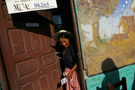 Image: Woman holds ballot