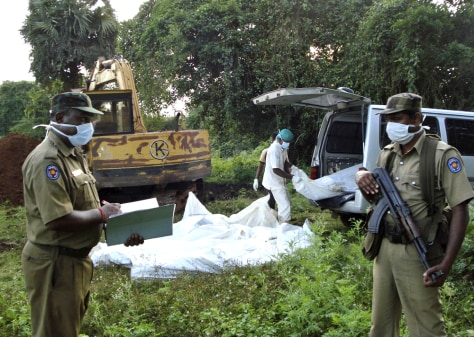Image: Health worker unloads the bodies of Tamil rebels