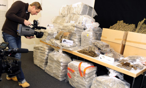 Image: A cameraman films packages containing drugs
