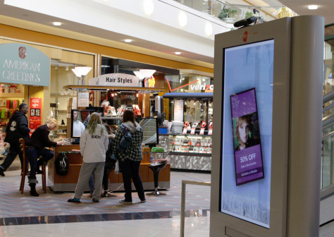 Image: Shoppers are shown near an advertising kiosk at the Hanes Mall in Winston-Salem, N.C.