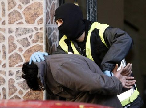 Image: Police detain a terror suspect in Mislata, Spain
