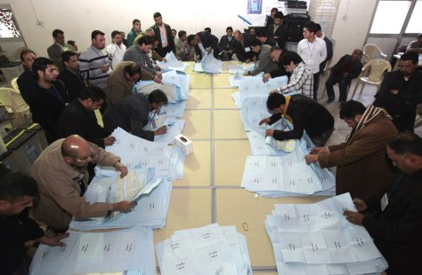 Image: Iraqi election officials count ballots