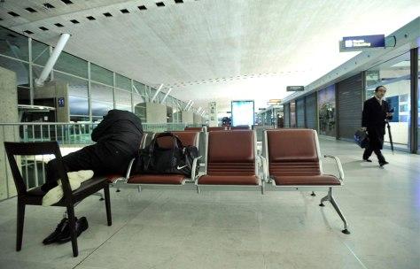 Image: A passenger sleeps inside Charles de Gaulle airport