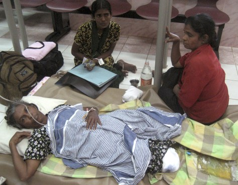 Image: A Tamil woman receives a treatment