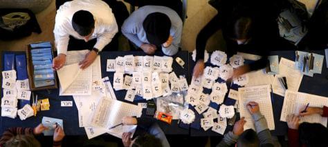 Image: teams of Israelis count votes