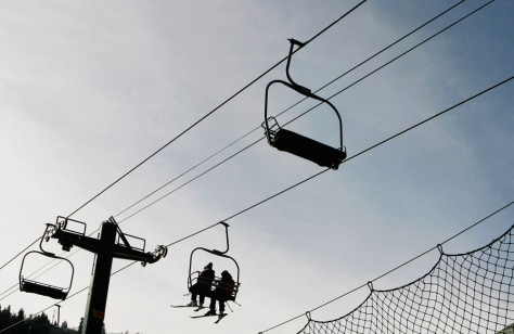 Image: Skiers ride the chair lift at Park City Resort