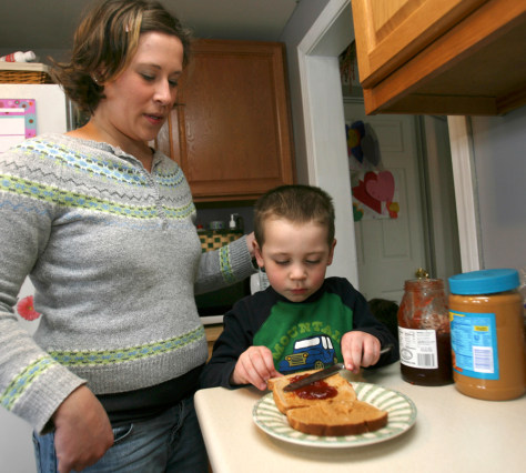 Image: Eleana Walsh watches her son Carter make his peanut butter and jelly sandwich.