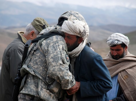 Image: Gen. Michael A. Ryan hugs a mournful Afghan man.