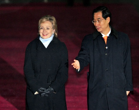 Image: Hillary Clinton escorted by Han Duck-Soo
