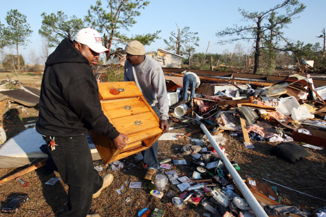 Image: Residents salvage furniture after twister
