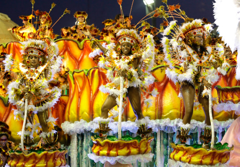 Image: Revellers of Unidas da Tijuca samba school dance atop a float during the first night of the Carnival parade in Rio de Janeiro's Sambadrome
