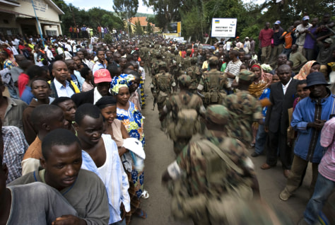 Image: Rwandan soldiers march past a crowd