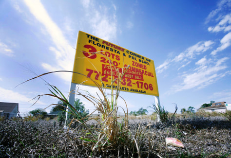 Image: A sign advertising lots for sale is seen in Port St. Lucie, Fla.