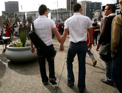 Two men walk hand in hand outside California Supreme Court during Proposition 8 demonstration in San Francisco