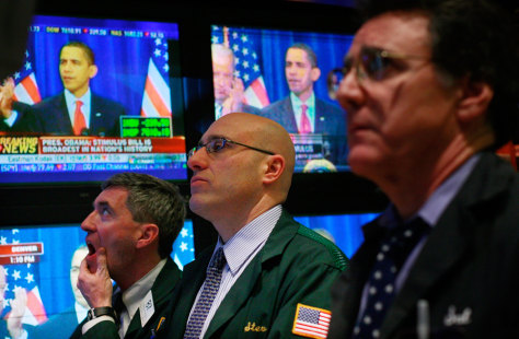 Image: Traders watch Obama