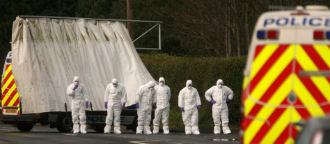 Image: Police forensic experts
