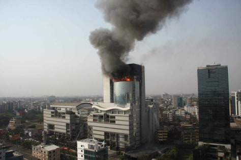 Image: Flames rise out of the burning Bashundhara City mall