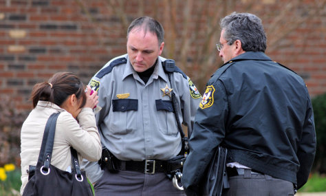 Image: Woman talking with police officers