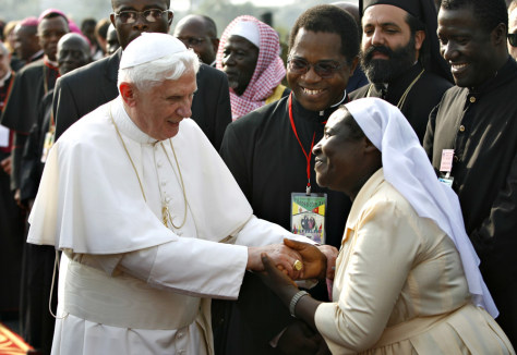 Image: Pope Benedict XVI is greeted by a nun in Cameroon