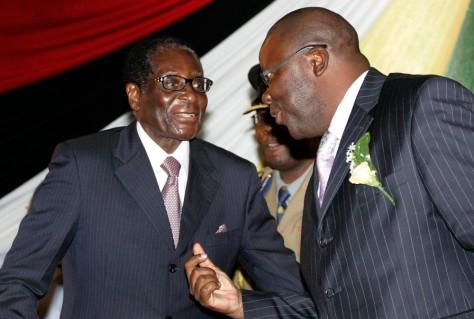 Image: Zimbabwe's President Robert Mugabe and Finance Minister Tendai Biti