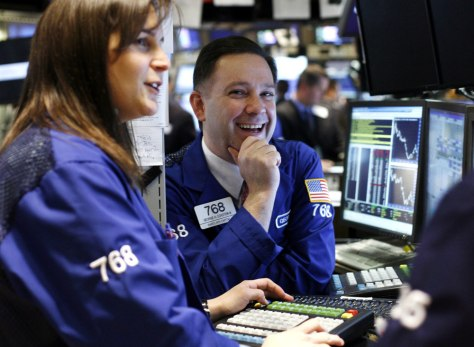 Image: A trader smiles on the floor of the New York Stock Exchange.