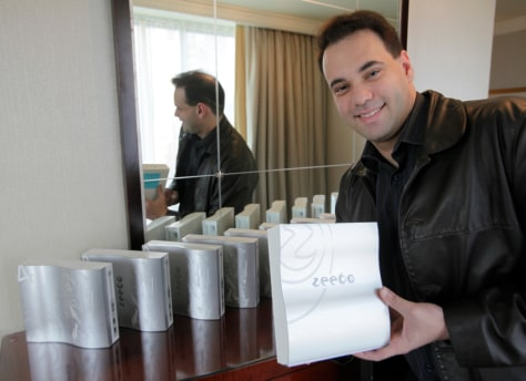 Image: Reinaldo Normand holds a Zeebo game console.