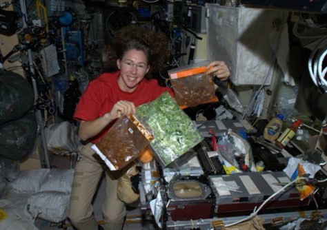 Astronaut experiments with space cooking - Technology ...