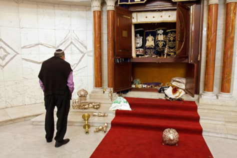 Image: A member of the Jewish community looks at a vandalized tabernacle in Caracas, Venezuela.
