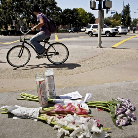 Image: Flowers are left near the spot where a driver hit two USC freshmen