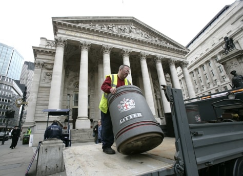 Image: A worker removes a litter bin