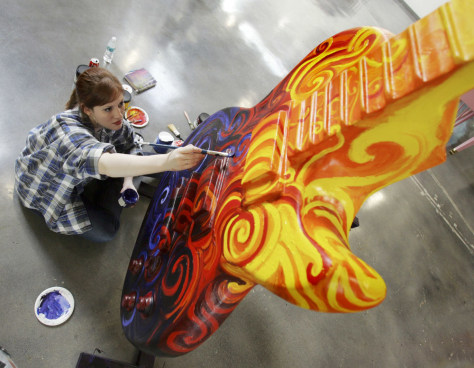 Image: Amanda Dunbar paints sculpture