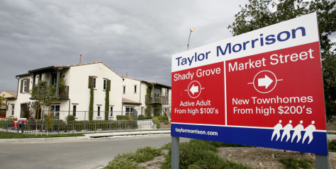 Image: A sign advertising homes for sale is seen in Corona